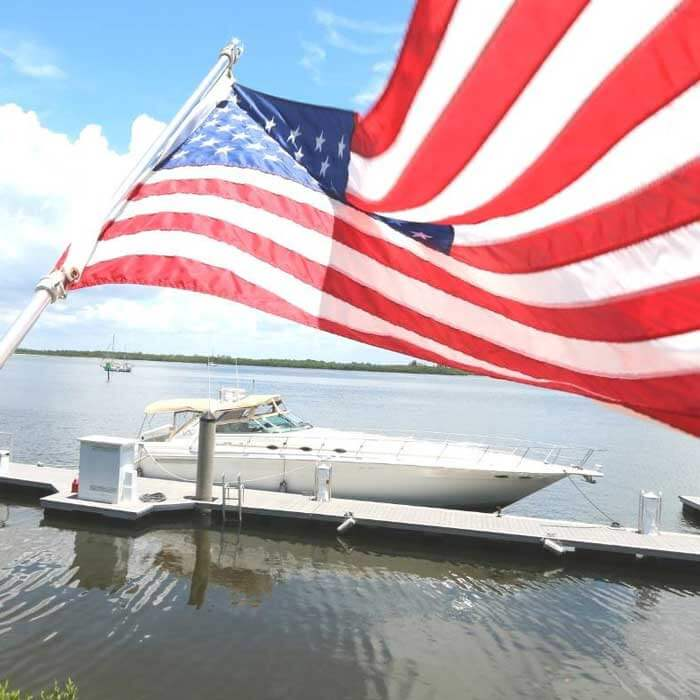 American flag waves by the Fort Myers marina at Pink Shell Resort