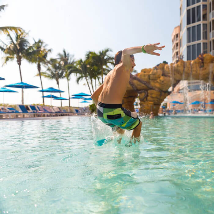 A boy jumps into the Octopool at Pink Shell Resort in Fort Myers